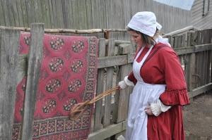 servant-carpet-beating