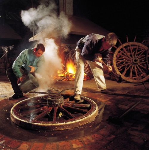 Skilled workers then use the factory-produced parts to construct the wheel.