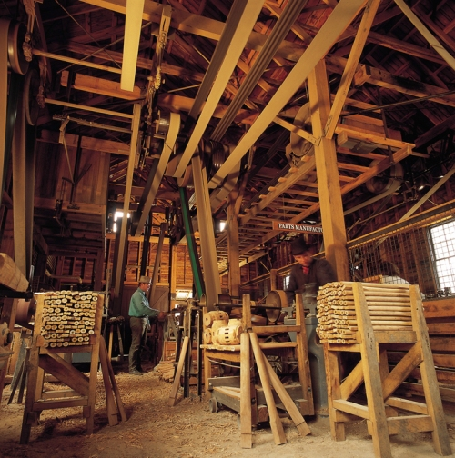Inside the wheelwright factory where timber is mass produced to make the wheels.